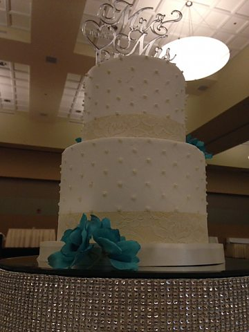 2 tier white buttercream with dots