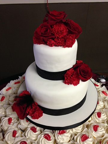 2 tier white fondant with red roses