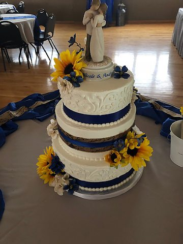 3 tier buttercream scrolls navy with sunflower
