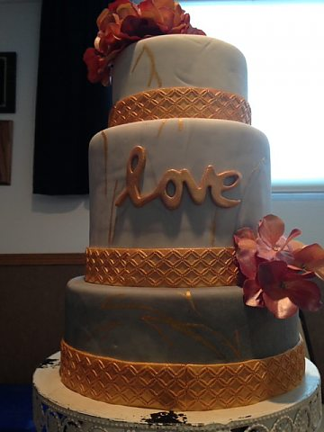 3 tier grey and white marble with gold fondant