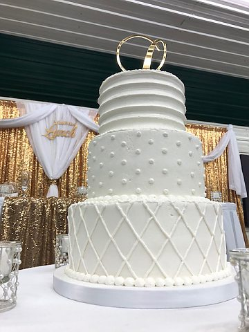 3 tier multi texture buttercream wedding cake