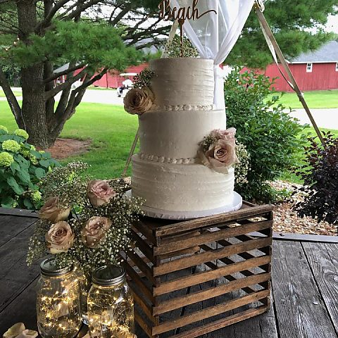 3 tier rustic comb with blush - displayed on rustic crate