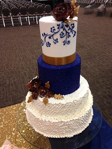 4 tier ruffled buttercream with bronze and royal blue