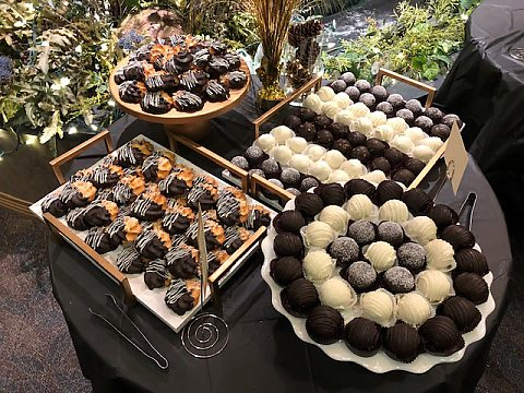 Assorted cake truffles and macaroons