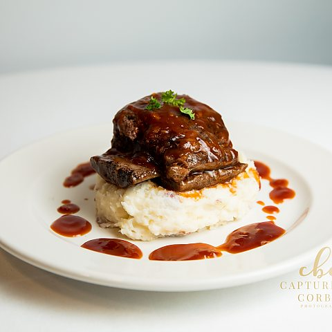 braised beef short rib over sour cream smashed potatoes